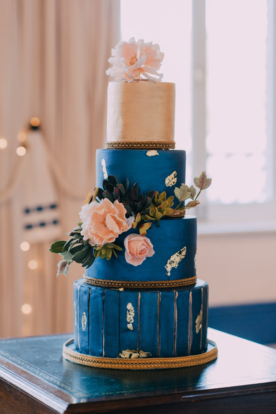 classic-blue-cake-with-gold-leaf